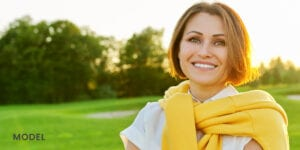 Older Woman in Yellow Sweater Smiling Outdoors